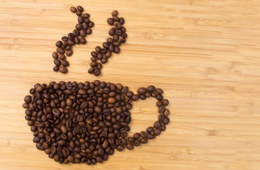 Coffee cup and steam made from beans, grain on wooden background
