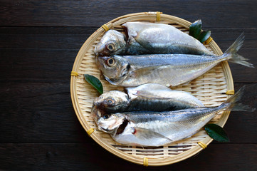 The Japanese horse mackerel or Aji fish on a bamboo basket