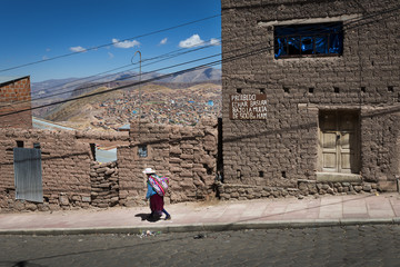 Potosi, Bolivia - November 29, 2013: Women wearing traditional clothes in the city of Potosi in Bolivia.