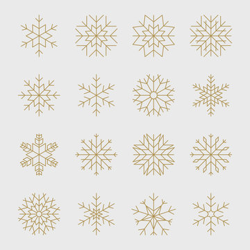 Set of gold geometric snowflakes for Christmas design.
