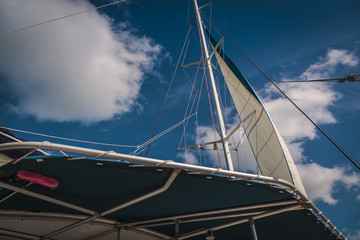 catamaran view from a low angle with background of sky and clouds