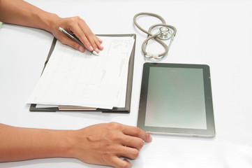 Doctor working with tablet at desk