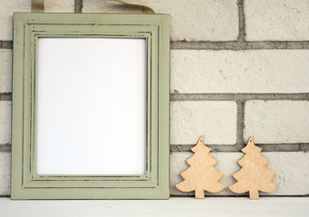 Christmas and New Year background. Empty picture frame, fir with with copy space blank tag on white background. Copy space image. Scandinavian style home interior decoration