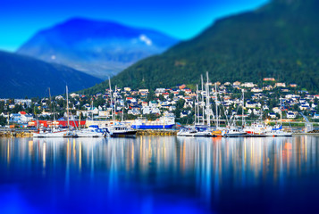 Tromso city with yachts tilted background