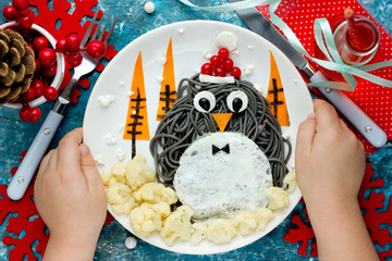 Fun food art idea for kids - penguin black spagehetti