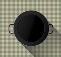 Paella pan empty on tablecloth
