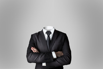 businessman without head crossed arms grey background Fotoväggar