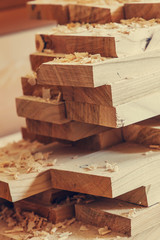 background with planks of wood shavings. wood construction material for background and texture. Wood processing. Joinery work. wooden furniture. timber structure background, close up.