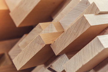 Wood timber construction material for background and texture. close up. Stack of wooden bars. small depth of field