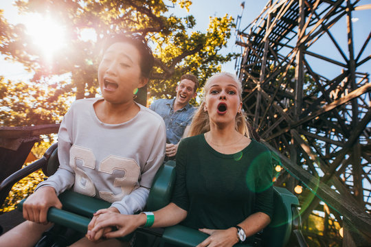 People enjoying a ride in amusement park