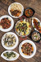 mixed portuguese traditional rustic tapas food selection on wood
