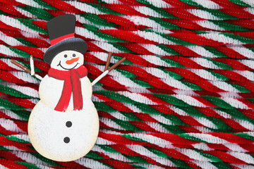 Snowman with candy cane pipes Christmas background