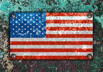 American flag on metal plate screwed screws on wall
