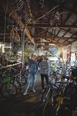 Mechanics examining a bicycle