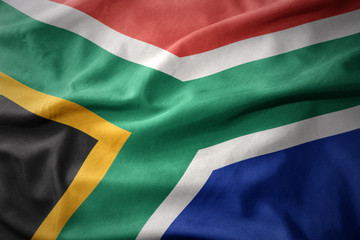 waving colorful flag of south africa.
