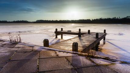 Wall Mural - Winter landscape frozen lake sunrise