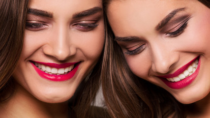 Beautiful sister twins with amazing smile.