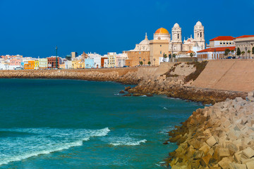 Wall Mural - Playa de la Santamaria beach and Cathedral de Santa Cruz in the morning in Cadiz, Andalusia, Spain