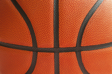 Close up shot of a basketball showing the seams