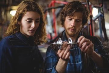 Mechanics repairing bicycle