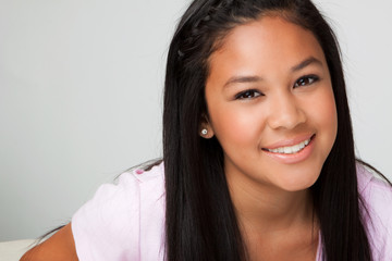 Happy Asian teenage girl.