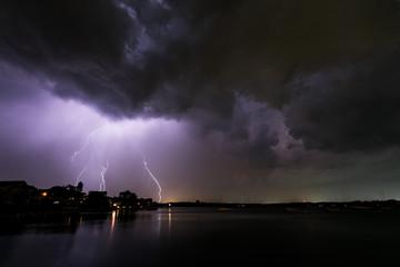 Foto op Canvas Onweer Lightning on the Bay