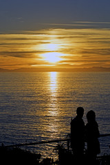 Sunset couple silhouette at Laguna Beach, California