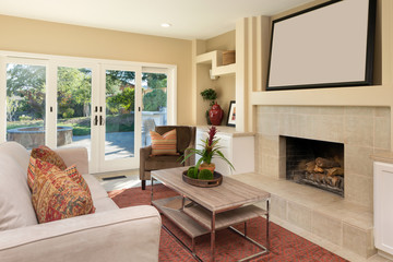 Living room with Fire place and framed copy space for your art.