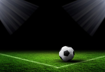 Soccer Ball and Grass on dark background