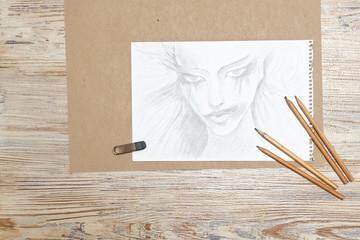Sketches girl, pencils and eraser.
