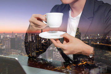 double exposure of business woman drink a coffee, tea and night cityscape as coffee break concept.