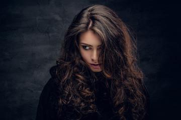Brunette female dressed in a black sweater.