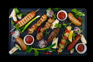 grilled assorted meat on black background