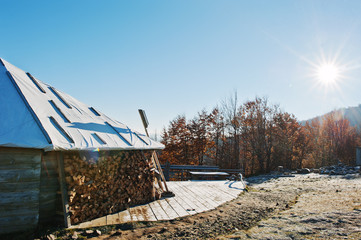 Teahouse with harvested wood on mountains with sumlight at froze
