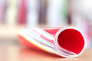 Close up edge of colorful magazine stacking roll with  blurry bo
