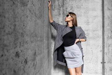 Wall Mural - high fashion portrait of young elegant woman outdoor.