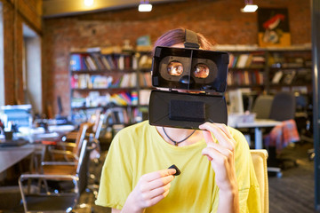 Female at the office play the fool with VR glasses