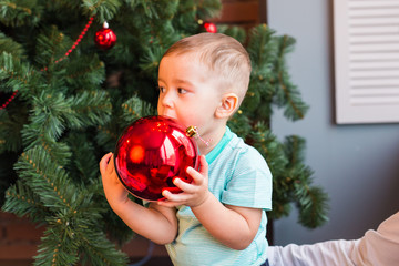 little baby boy with christmas ball