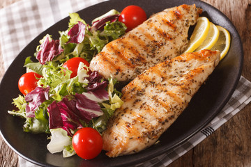 Grilled chicken breast with mixed salad close-up. horizontal