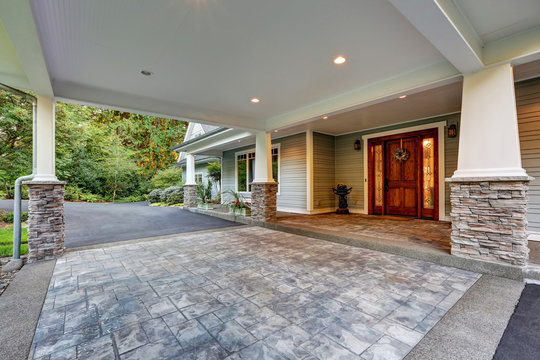 View of driveway with an all weather covered entry