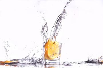 oranges splashing into martini glass