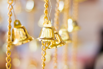 golden christmas bells hanging as new year toys and gift