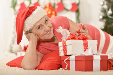 Senior woman with gifts
