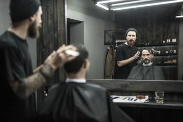 Stylish man in barbershop
