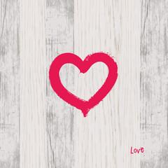Brush heart shape on wood. Decorative background.