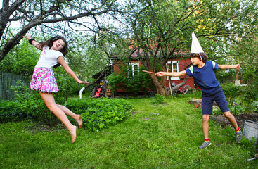 siblings boy and girl play harry potter game