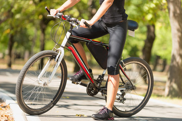 Bicycle ride. Female biker