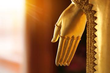 Gold hand of Buddha statue
