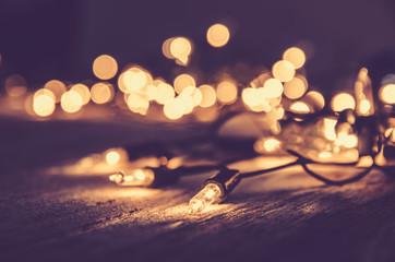 christmas light decor on wood background , color filter vintage tone