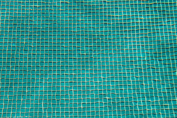 Tiles on the bottom of a swimming pool.